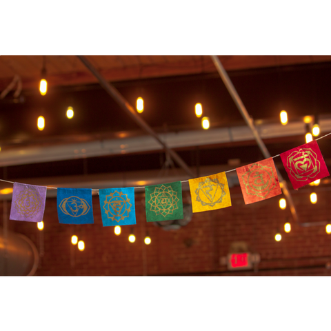 chakra garland hanging with fairy lights