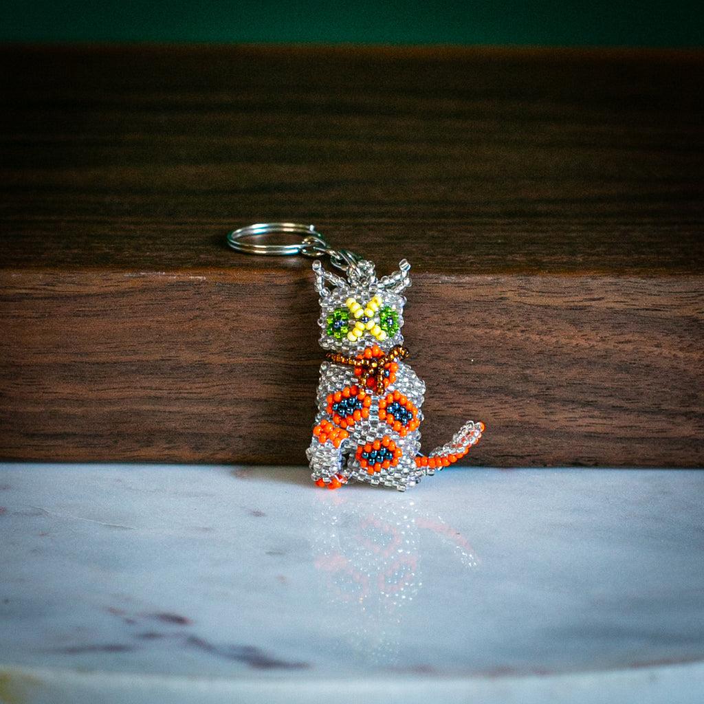 cat keychain on table