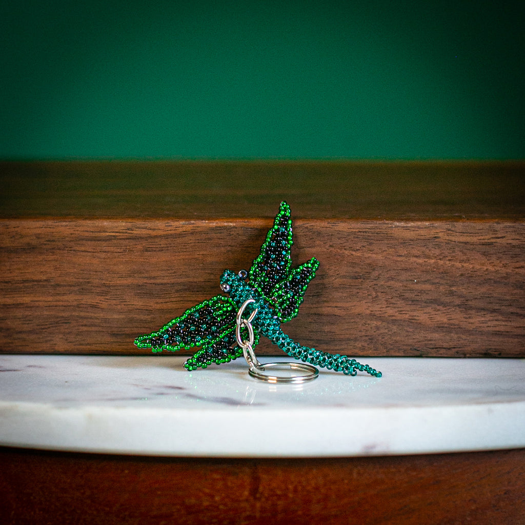 beaded dragonfly keychain on table