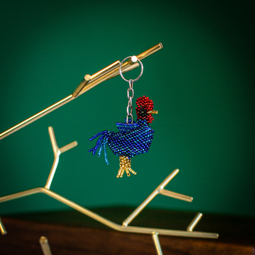 beaded rooster key chain on gold tree stand