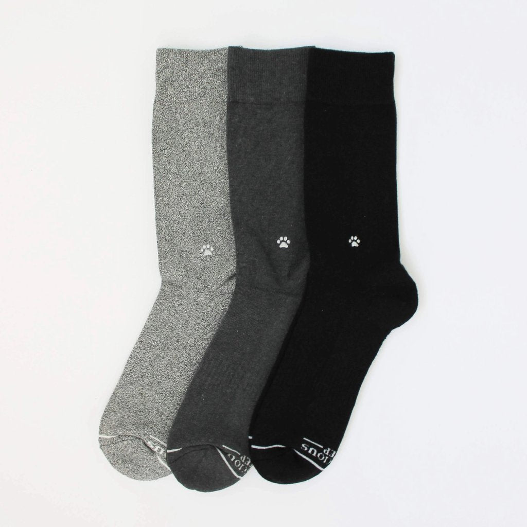 black socks that save dogs save them all fair trade
