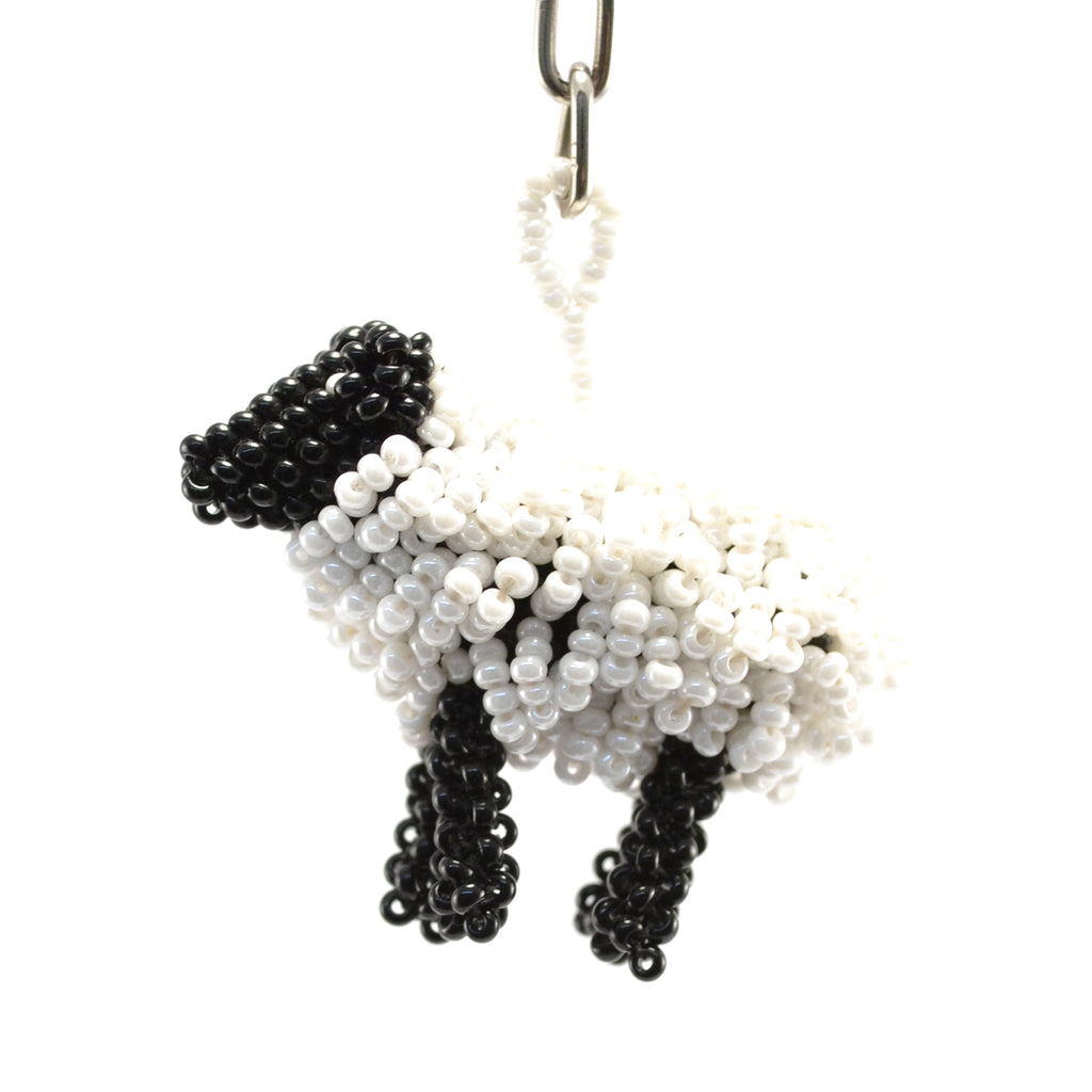 beaded keychain white body black face