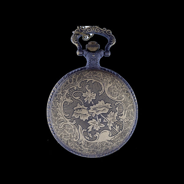 brass pocket watch floral design back