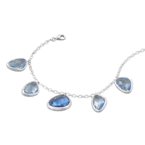 Rhodium Plated Bracelet with Abstract Faceted Blue Glass Drops