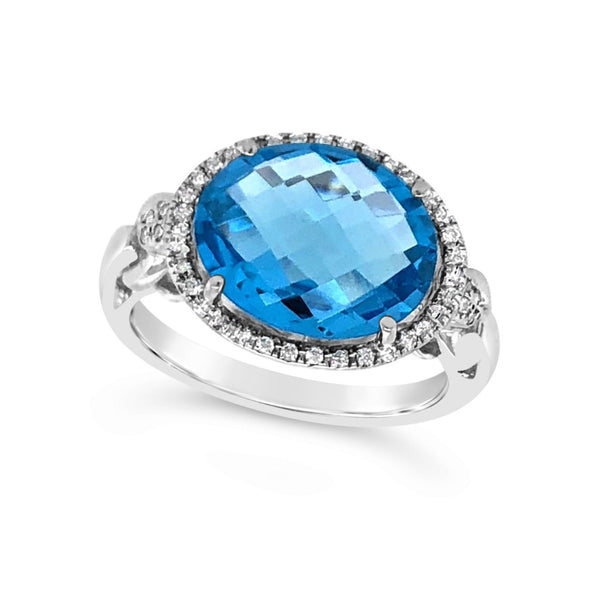 Oval Blue Topaz and Diamond Halo Ring