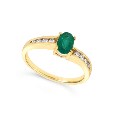Oval Emerald and Channel Set Diamond Ring