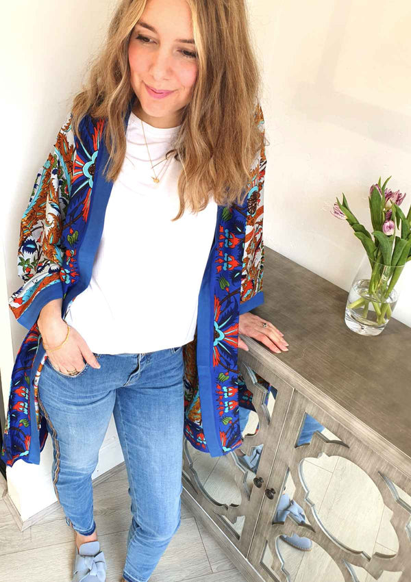 blue skinny sumner frame jeans with white tee and decadent collared kimono