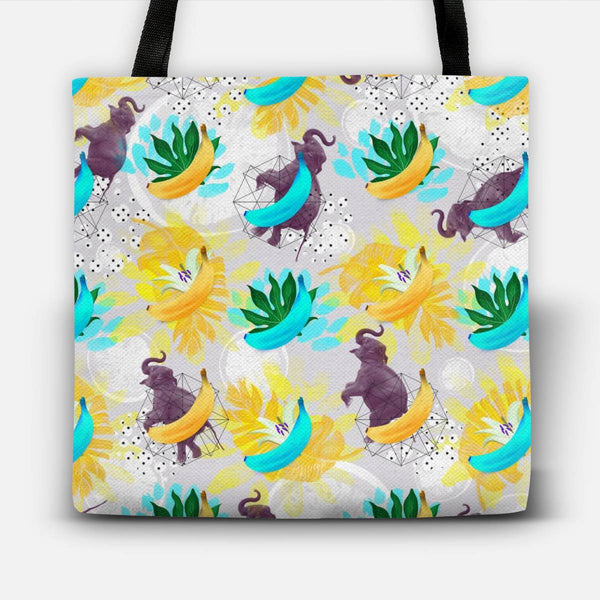 Elephants between fruits and plants Tote Bag