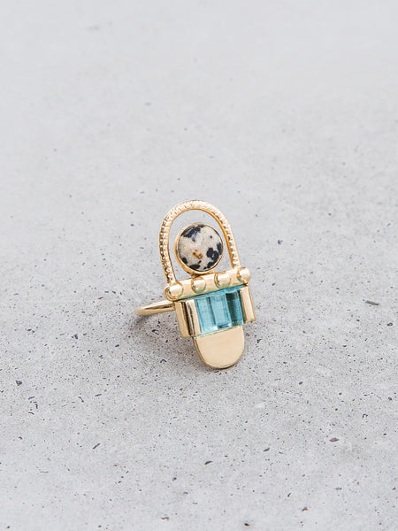 art deco 1920s glass gold vermeil statement ring metalwork jewelry by Dianna Gendron soft gold co aquamarine Dalmatian jasper arch on concrete