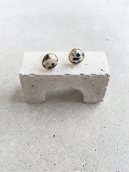 black white cream dalmatian jasper stud earrings on concrete arch softgoldco