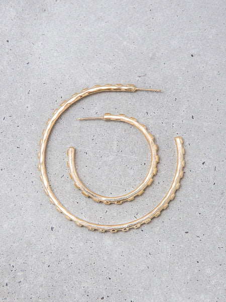 large textured sculptural dot gold hoop earrings modern metalwork jewelry soft gold co by dianna gendron