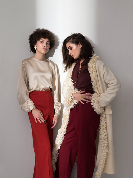 soft gold co x dead byrd vintage fall winter lookbook 2 models elegant chic red high waist flare trousers silk blouse shag wool coat statement earrings