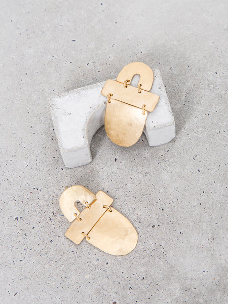 abstract arch geometric shapes earrings dangles gold statement earrings soft gold co by dianna gendron arch half moon shot on concrete