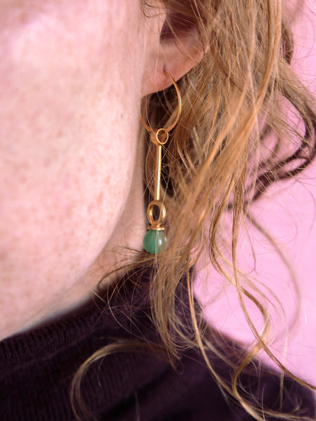 stoned circle drop statement single earring worn soft gold co