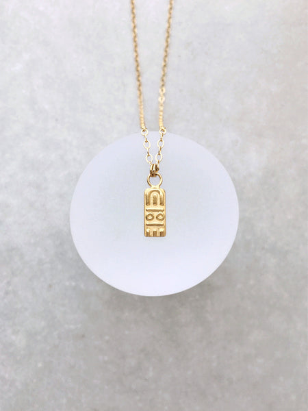 glyph pendant necklace woman's body venus of willendorf ancient antique inspired Egyptian revival gold dainty delicate choker