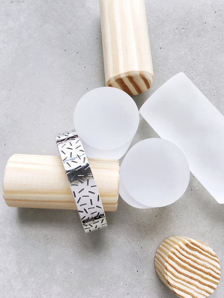 softgoldco gold confetti wide cuff bracelet sterling silver clear pillars concrete wood lookbook memphis pattern