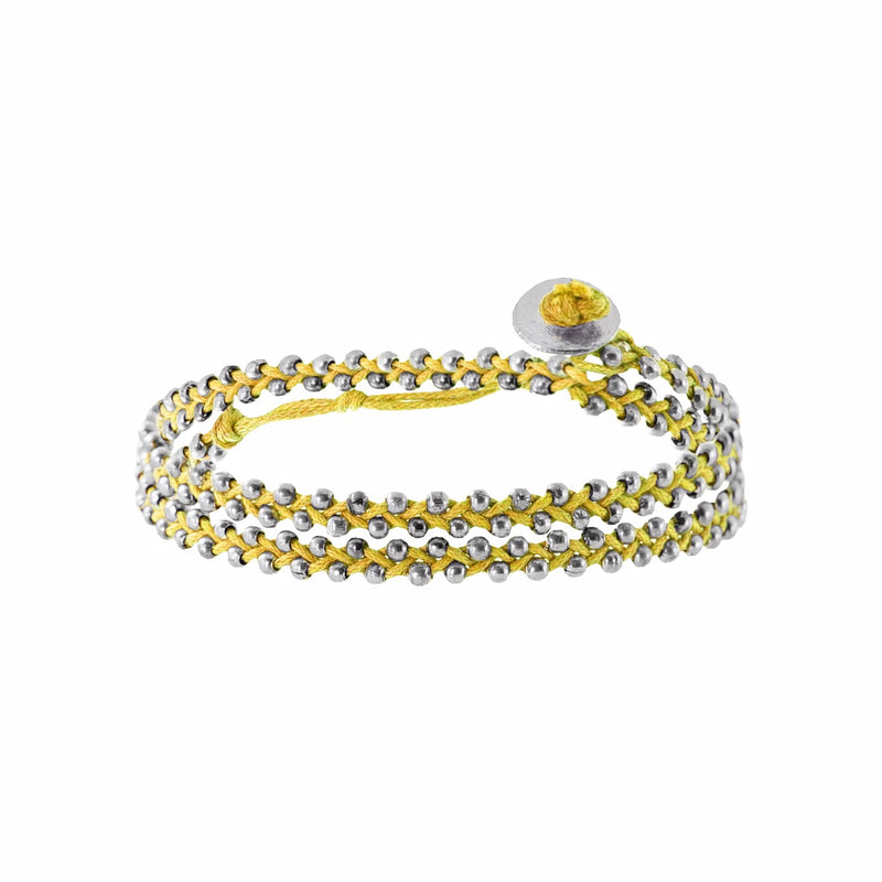 Yellow string bracelet w/ silverish beads