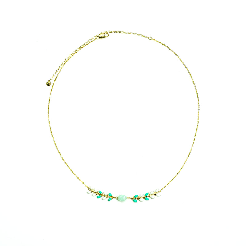 Gold necklace w/ white and green enamel details and blue stone