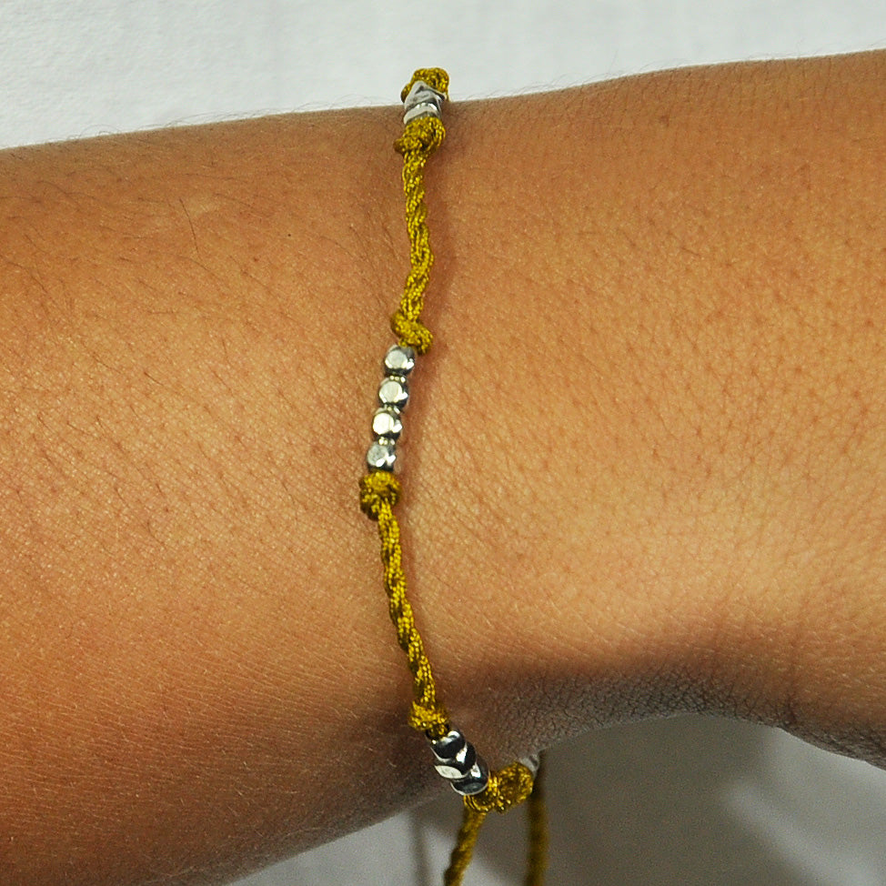 Dark Yellow Bracelet w/ Silver Beads & Tassels
