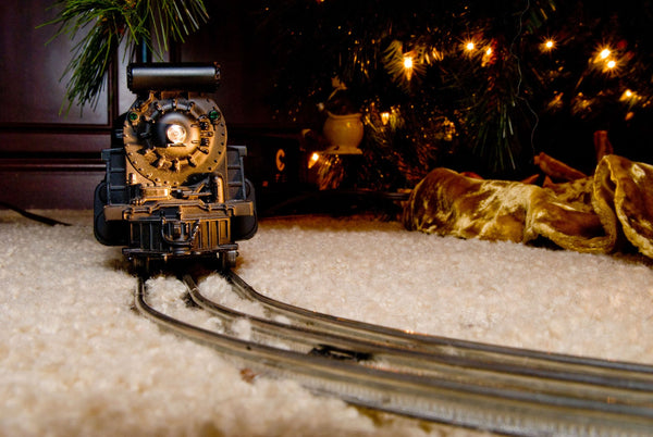 model train engine by the Christmas trees