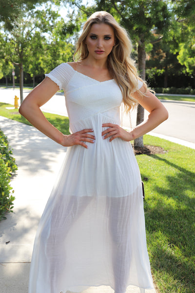 IN CHASE OF THE SUN WHITE DRESS