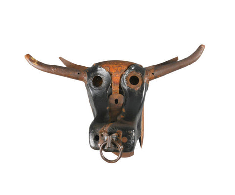 A Metal Sculpture of a Bull's Head