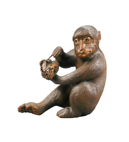 A Japanese Carved and Painted Monkey
