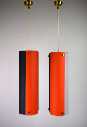 A Pair of Orange, Brown, and White Hanging Lights