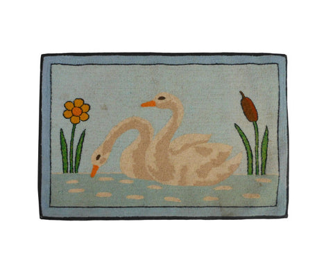 A Folk Art Hooked Mat of a Pair of Swans