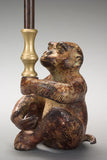 A Patinated Bronze Monkey Candleholder