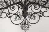 A Pair of Wrought Iron 5 Light Sconces