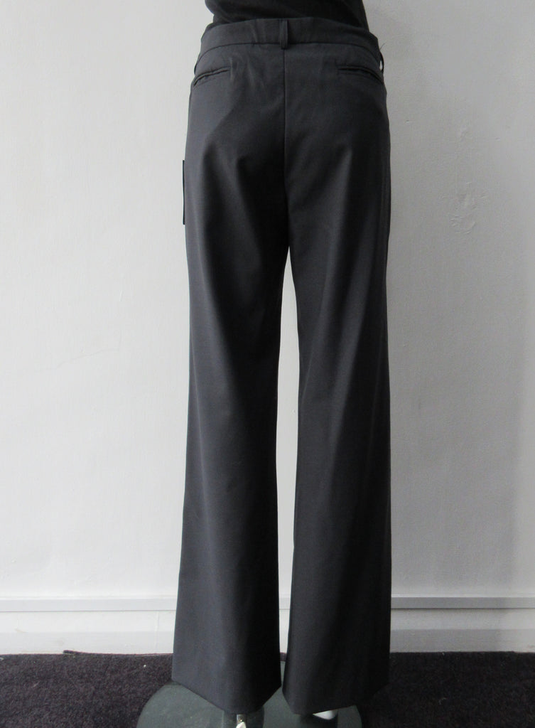 Charcoal grey wool trousers with side welt pockets. Size 8. 100% Wool Dry Clean Only. Inseam 80cm, Outseam 105cm