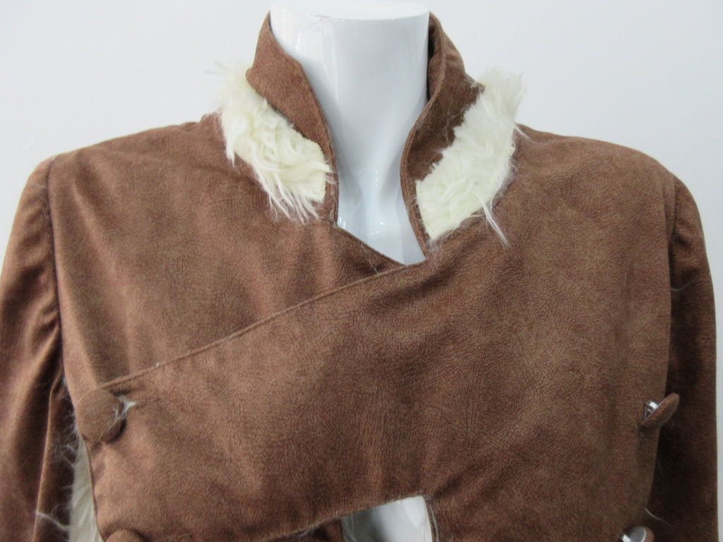 Split Suede Coat. Faux suede coat with faux fur contrast trim on lapels and inside. Flared towards hem with contrast faux fur panels. Rich saddle lighter brown colour. Feminine version inspired from 18th century men's evening coat. Multiple ways of buttoning as illustrated. Can be paired with 060301 Brown Suede Trouser. Formerly a showpiece, specially made. No Label. CB Length 94cm. Sleeve length from side shoulder point 75cm. 850g approximate weight. 95% Polyester, 5% Rayon. Contrast: 100% Viscose.  Dry Cl