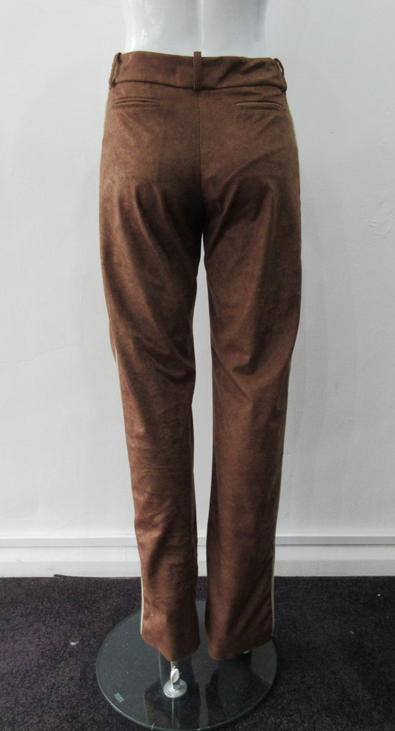 Brown Faux Suede Trouser. Nicely tailored medium brown faux suede trousers with beige contrast piping. Front angle invisible zip pockets. Can be paired with 060218 Split Suede Coat. Formerly a showpiece, specially made. Inseam 83cm. Outseam 103cm. 400g approximate weight. 95% Polyester, 5% Nylon. Dry Clean Only. Made in Canada