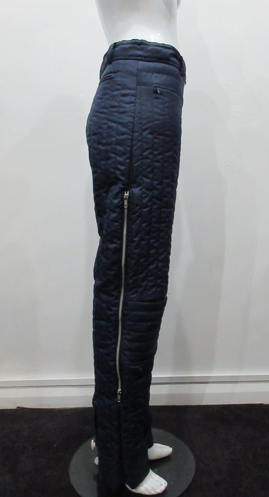 Navy blue padded trousers in 80's parachute inspired design. Large metal zippers on side seam plus invisible zippers on knee pocket panel seams. Size 8