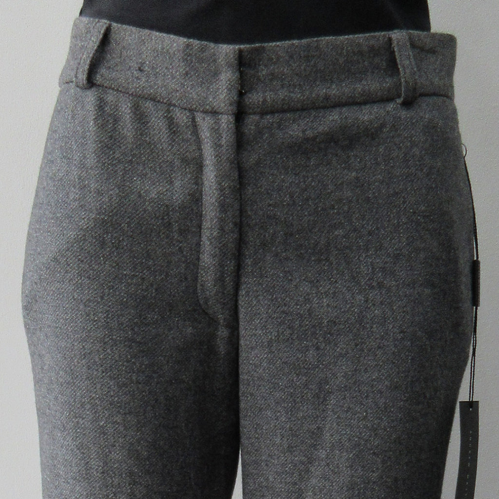 Soft wool trouser with relaxed fit. Size 8, Inseam 88.5cm, Outseam 108cm, 100% Wool, Dry Clean Only. Made in Croatia
