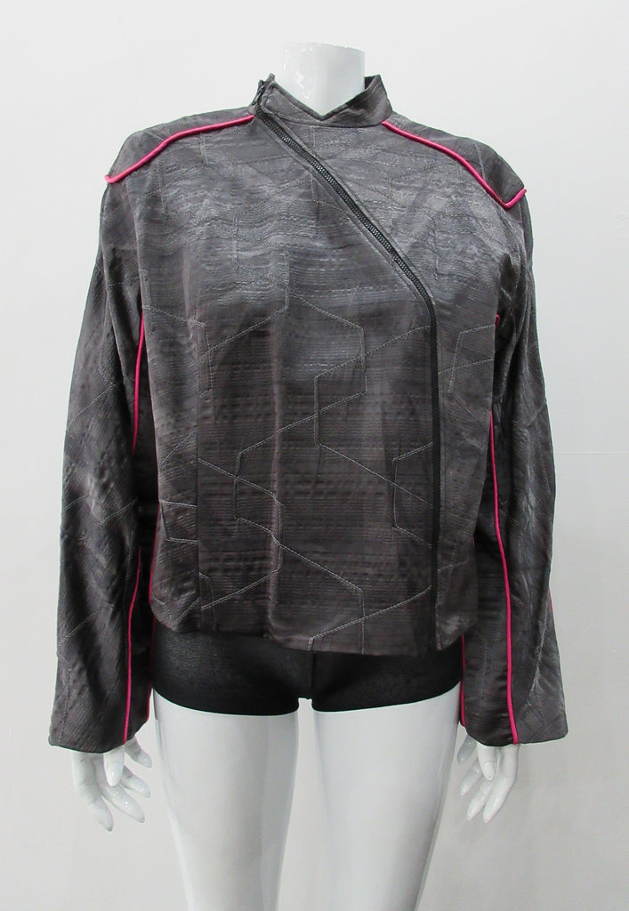 Side Zip Jacket. Assymetrical side front zip jacket featuring abstract stitching incorporated into the fabric for a geometric feel. Rich deep grey colour with pink piping accents on shoulder and sleeve panels. Fully lined. CB length 53cm. Sleeve length from side neck point 75cm. 400g approximate weight. 29% Nylon, 22% Viscose, 28% Cotton, 12% Linen, 2% Polyester. Lining: 100% Rayon. Dry Clean Only. Made in Canada