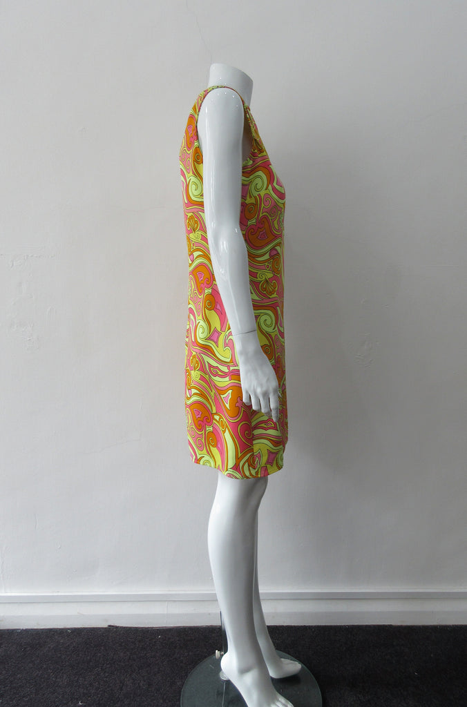 Bright Yellow Print Dress. Below the knee dress with 60's style yellow, pink and orange design. Chinese style piping trim accent in yellow satin piping. CB zipper. Fully lined.