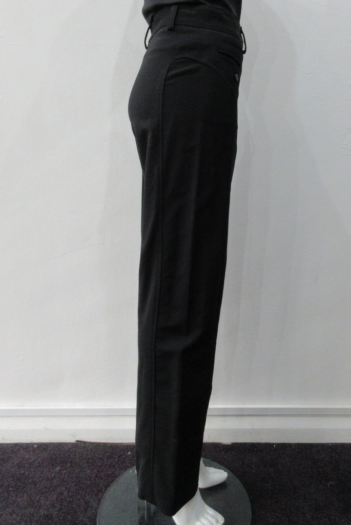 Fully tailored black slightly stretch trouser. Low-cut waist with side pockets above paneled seam. Size 8. Inseam 81.5cm, Outseam 100cm