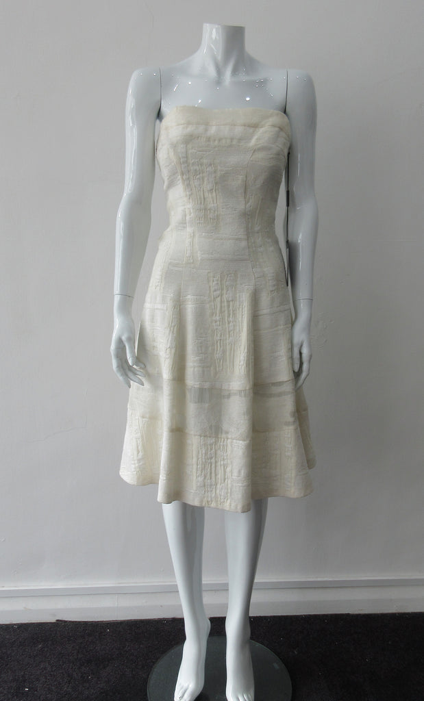 Multi corded velvet and floral trimmed off white dress with top panel for comfortable fit. Flattering slight swing below the waist for bit of ease. Size 8, CB Length 93cm, 450g approximate weight. 62% Viscose, 20% Wool, 15% Silk, 3% Cotton Contrast: 38% Nylon, 26% Wool, 20% Cotton, 16% Viscose Dry Clean Only. Made in Croatia