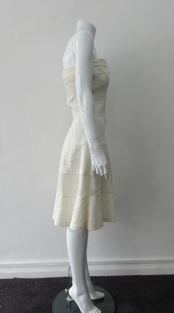 Multi corded velvet and floral trimmed off white dress with top panel for comfortable fit.  Flattering slight swing below the waist for bit of ease.  Size 8  CB Length 93cm 450g approximate weight  62% Viscose, 20% Wool, 15% Silk, 3% Cotton Contrast: 38% Nylon, 26% Wool, 20% Cotton, 16% Viscose Dry Clean Only  Made in Croatia