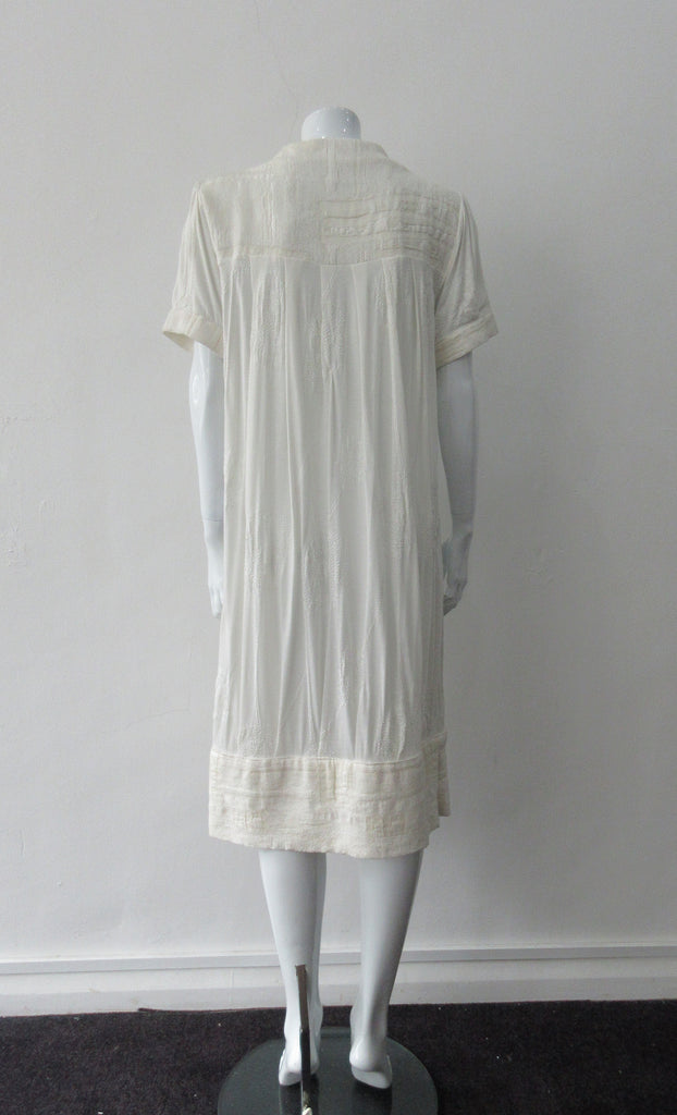 Half Pleat Dress:  Art-Nouveau style with pleats to add fullness into tapered hem. Invisible zipper on shoulder. Falls mid calf  Size 8. CB Length 105cm, 350g approximate weight. 62% Viscose, 20% Wool, 15 %Silk, 3% Cotton Contrast: 46% Modal, 34% Nylon, 10% Angora, 10% Viscose, Dry Clean Only, Made in Croatia