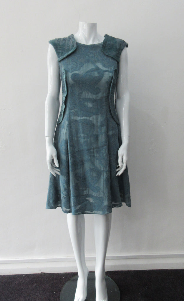 Trenched Swing Dresss. Dark sea green textured dress with trenchcoat-style panels. With CB zipper. CB length 92cm. 600g approximate weight. 37% Nylon, 25% Wool, 20% Cotton, 15% Viscose, 3% Silk. Dry Clean Only, Made in Croatia