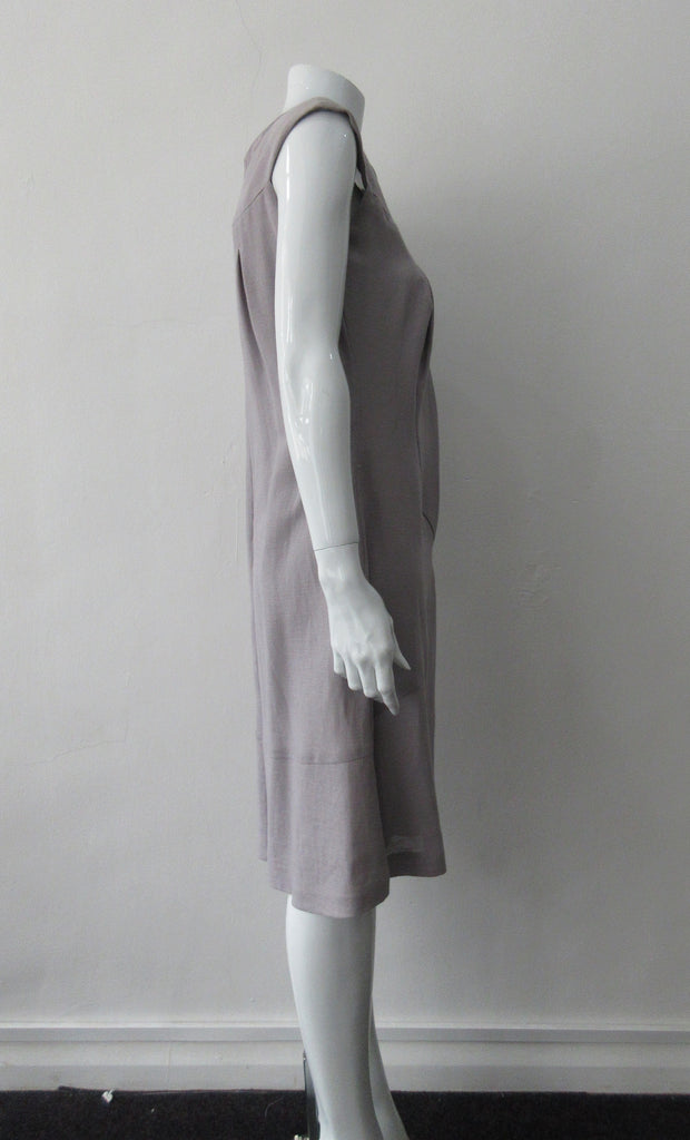 Pleated Cross Seam Dress. Blue-Grey dress with cross seam panel details. Falls below the knee. 65% Linen, 35% Cotton. Contrast: 58% Nylon, 42% Polyester Lining: 100% Rayon Dry Clean Only. 250g approximate weight. Made in Croatia