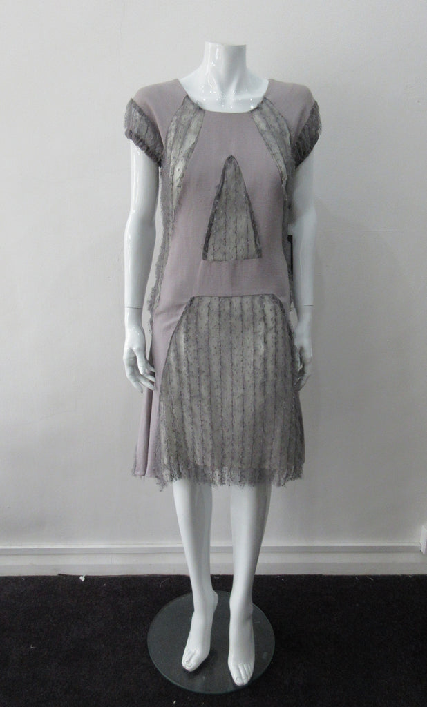 A Dress, Blue-Grey A-line dress with custom built textured netting panels. 65% Linen, 35% Cotton. Contrast: 98% Polyamide, 2% Polyester Lining: 100% Rayon. Dry Clean Only. 250g approximate weight. Made in Croatia