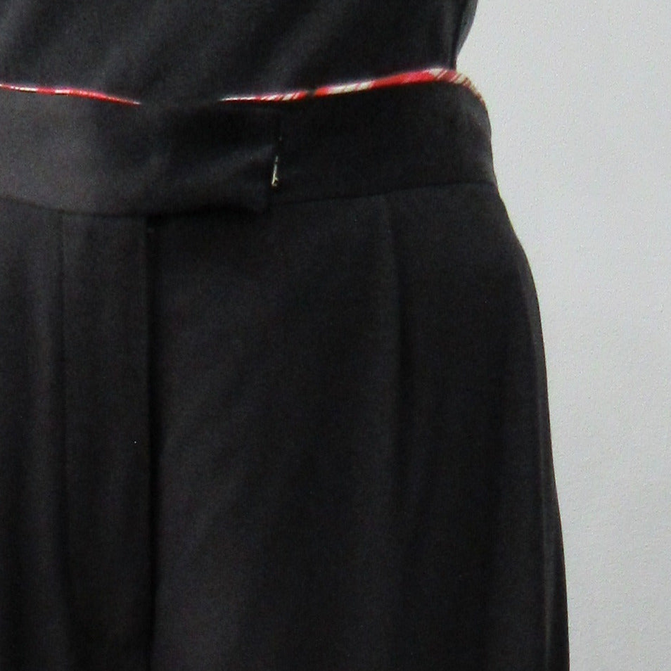 Soft flowing flared trouser with inside cntrast waistband trim.  Black colour.  Size 10 Inseam 81.5cm, Outseam 106cm, 100% Polyester Contrast: 100% Silk, Dry Clean Only, 240g approximate weight. Made in England