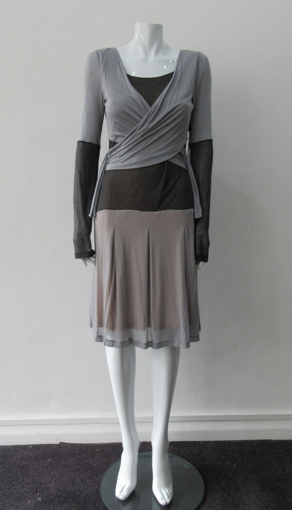 Double Fold Dress. Roman style pleat fold dress in very comfortable soft jersey. Soft grey with Chocolate Brown contrast panels. Long sleeved, side invisible zipper. CB Length 96.5cm, Sleeve Length 73cm. 400g approximtate weight. 100% Modal, Dry Clean Only, Made in England