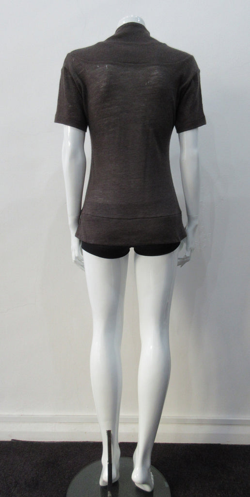 T-Shirt style with short sleeves featuring curved panel parallel to neckline and soft dropped round collar. Soft wool fine knit in rich brown colour. Size 8