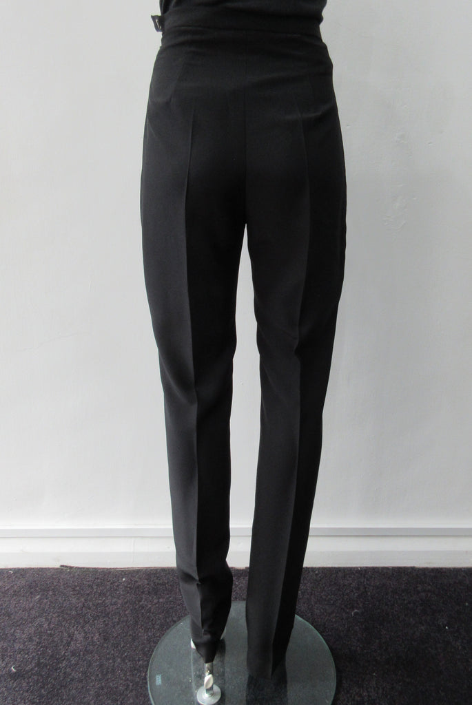 Higher waisted black trouer with tight waist and tapered hems. Contrast print inside waistband. 100% Poyester Crepe Contrast: 100% Silk Dry Clean Only. Exceptional tight fit with small raised waist, more suitable for a very slender figure. Size 6 or XS, Inseam 88cm