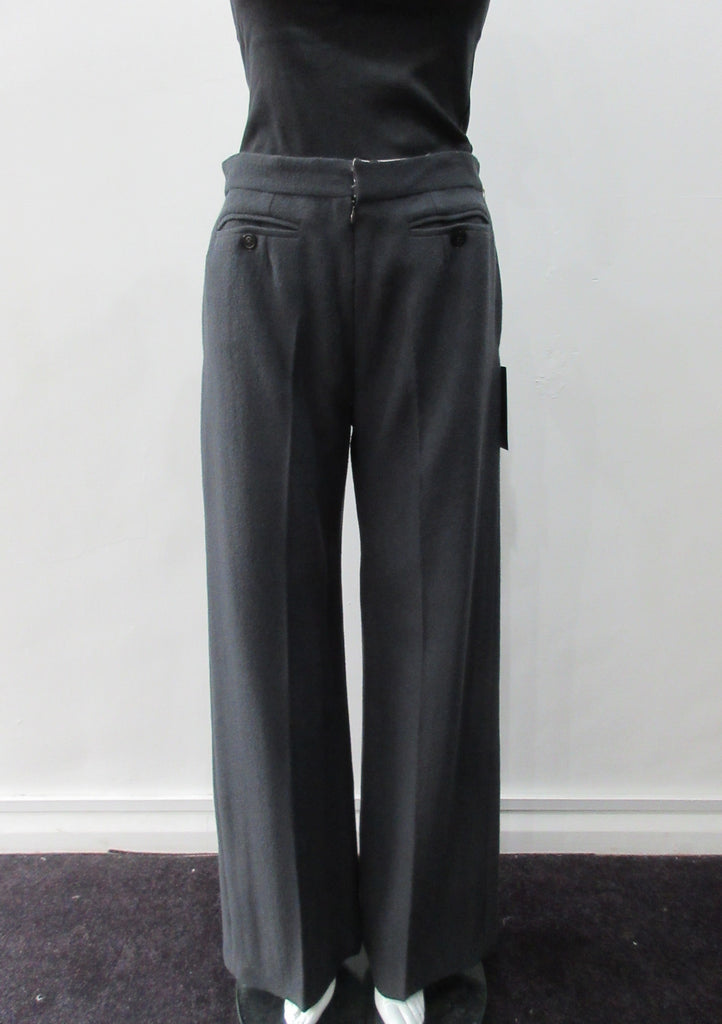 110112 Tailored Touser. Deep Grey Wool Crepe flowing with flared hem, Reverse pocket details on front. Size 8, Inseam 85cm, Outseam 106cm, 100% Wool, Contrast: 100% Cotton, Lining: 100% Rayon, Made in England
